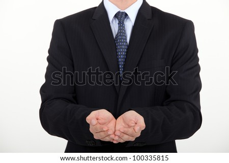 Businessman holding hands out - stock photo