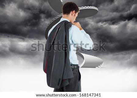 Businessman holding his jacket against winding staircase in the sky