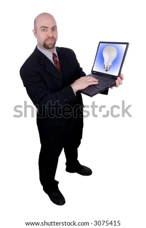 Businessman holding his laptop with a lightbulb on the screen isolated over white with a clipping path - stock photo