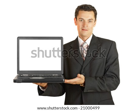 Businessman holding his laptop with white screeen isolated on white
