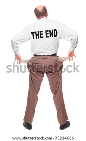 Businessman holding his two empty pockets with notice The End. Bankruptcy concept. - stock photo