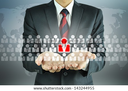 Businessman holding Human Resources sign - HR, HRM, HRD concept - stock photo