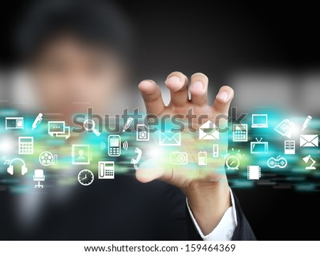 Businessman holding icon - stock photo