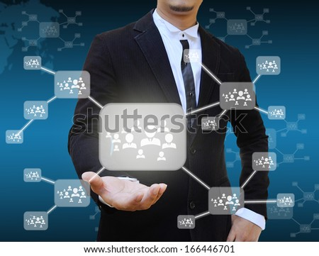 Businessman holding icon of social network - stock photo