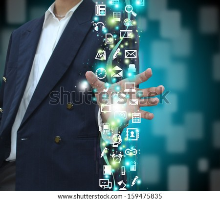 Businessman holding icons