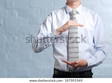 Businessman holding imaginary idea in hands - insert own concept - stock photo