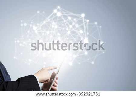 Businessman holding in hand tablet with global connection concept