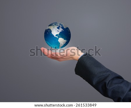 Businessman holding in his hand earth globe. Grey - Stock Photo