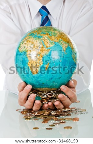 Businessman holding in his hands coins and a globe - stock photo