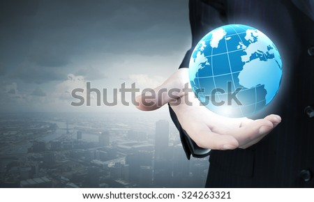 Businessman holding in palm digital Earth planet - stock photo