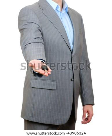 Businessman holding key isolated on white background - stock photo