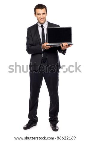 Businessman holding laptop - stock photo