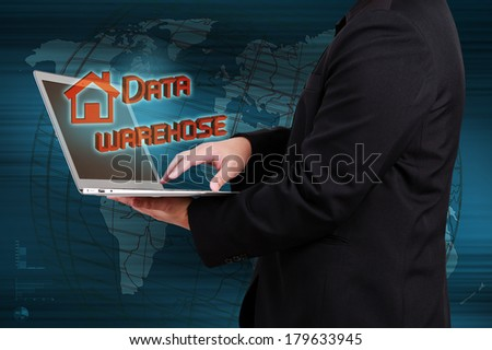 businessman holding laptop and show data warehouse concept - stock photo