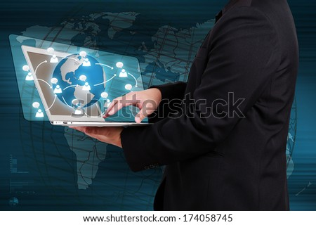 Businessman holding laptop show a social network on virtual screen. Concept of business communication. - stock photo
