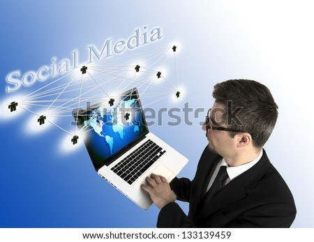 Businessman holding laptop with 3D social media on top - stock photo