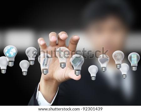 Businessman holding lightbulb - stock photo