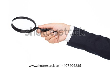 Businessman holding magnifying glass isolated on white background - stock photo