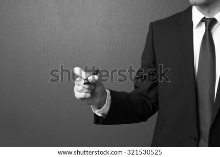 businessman holding marker prepare to write - stock photo