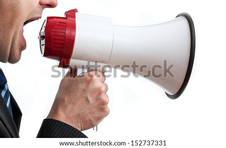 Businessman holding megaphone and shouting, isolated - stock photo