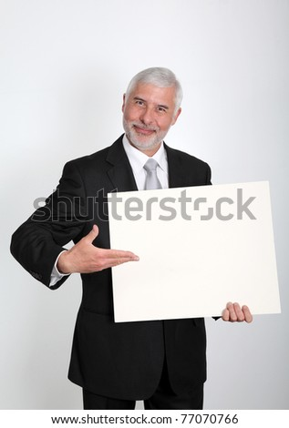 Businessman holding message board - stock photo
