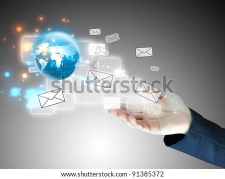 Businessman holding message , connected - stock photo