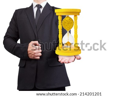 businessman holding million dollar coin in vintage hourglass isolated on white background with clipping path - stock photo