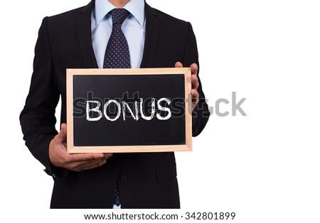 Businessman holding mini blackboard with BONUS message - stock photo