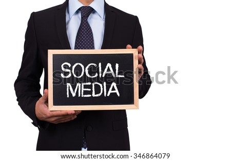 Businessman holding mini blackboard with SOCIAL MEDIA message