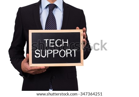Businessman holding mini blackboard with TECH SUPPORT message