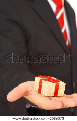 businessman holding mini gift package in hand - stock photo