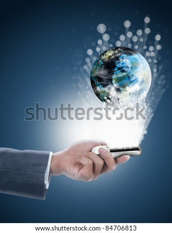 businessman holding mobile phone with globe and fiber optics - stock photo