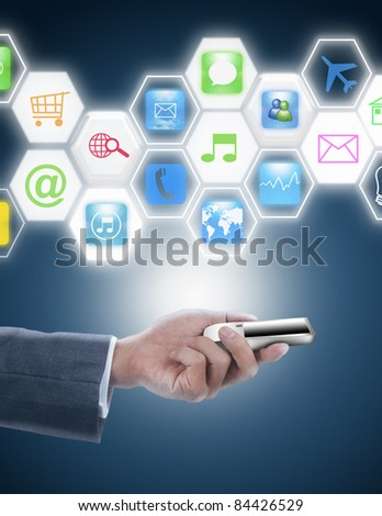 businessman holding mobile phone with hexagon screen and icon - stock photo
