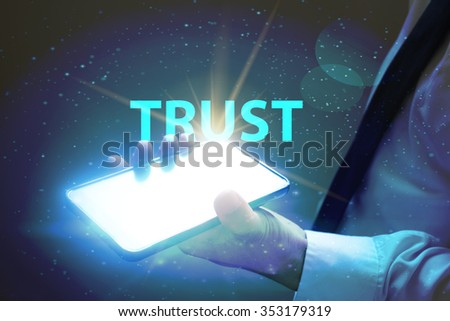 businessman holding mobile phone with TRUST text on virtual screen. Internet concept. Business concept. Business idea - stock photo