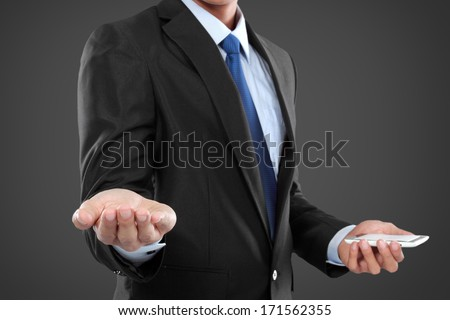 businessman holding mobile smart phone, another hand presenting. ready for your design - stock photo