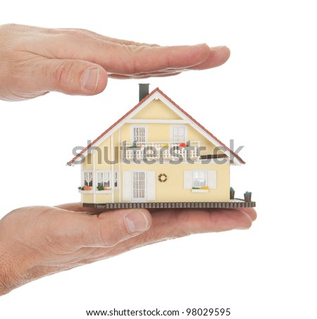 Businessman holding model of a house in his hands. Real-estate insurance concept - stock photo