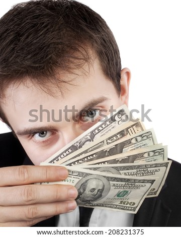 Businessman holding money with face behind dollars