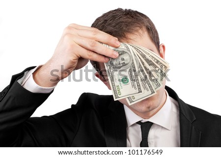 Businessman holding money with face behind dollars isolated on white