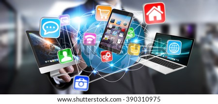 Businessman holding multimedia tech devices in his hand - stock photo