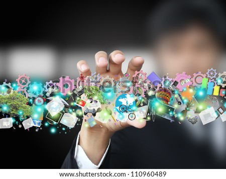 Businessman holding object - stock photo