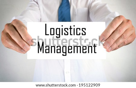 Businessman holding or showing card with Logistics Management - stock photo