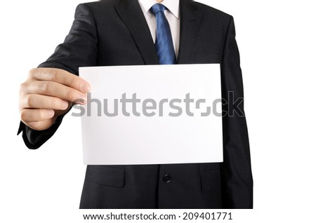 Businessman holding or showing empty card - stock photo