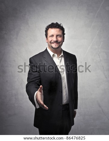 Businessman holding out his hand - stock photo
