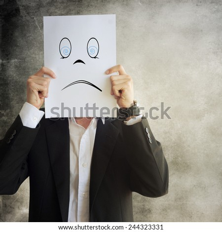 Businessman holding paper with face expression