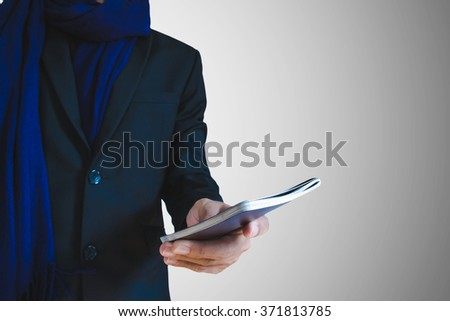 Businessman holding passport or ID card on hand, selective focus on hand - stock photo