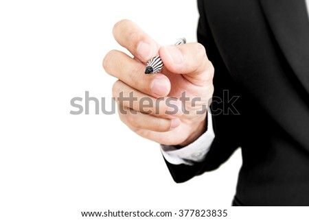Businessman holding pen in writing position to screen, selective focus, isolated on white background - stock photo