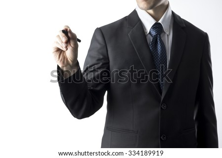 Businessman Holding Pen Writing Pose. Business Concept - stock photo