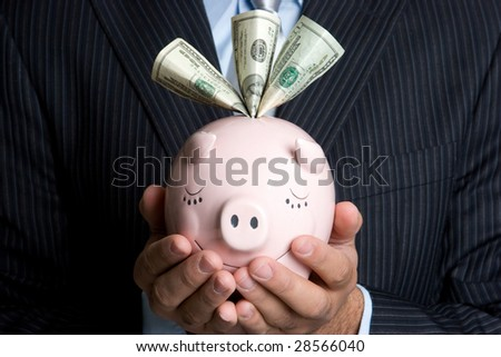 Businessman Holding Piggy Bank - stock photo