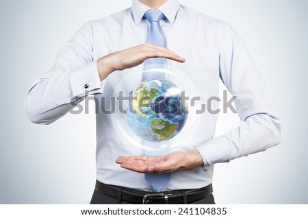 businessman holding planet. Elements of this image furnished by NASA - stock photo