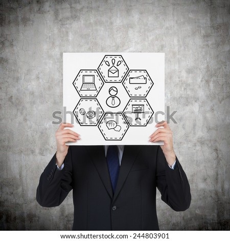 businessman holding poster with business diagram - stock photo