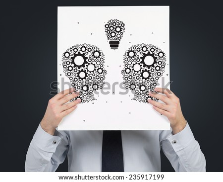 businessman holding poster with drawing head - stock photo